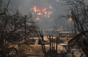 Fires Strike a Blow to the Anaheim Hills: At Least 10 Killed and More than 5000 Homes Evacuated